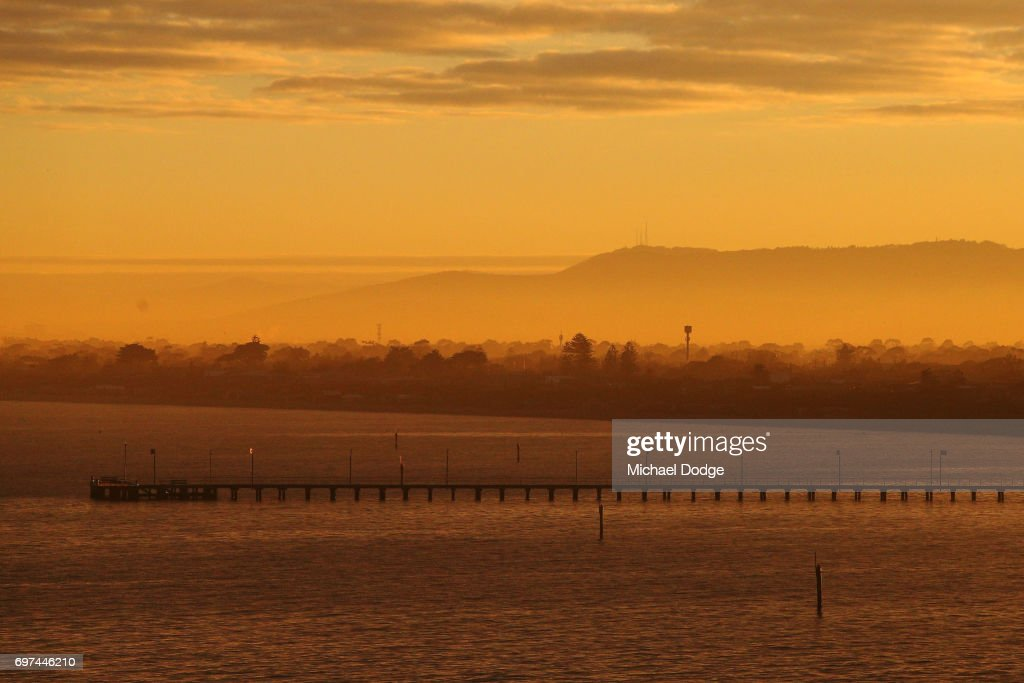 A view of Frankston foreshore is seen as morning fog decends over the far Dandenong Ranges during sunrise on June 19, 2017 in Melbourne, Australia.