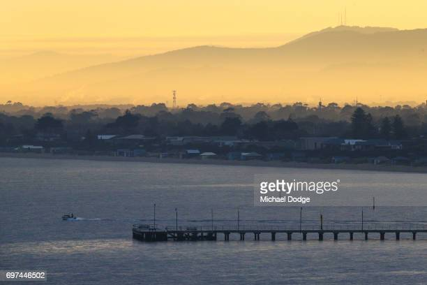 A view of Frankston foreshore is seen as morning fog decends over the far Dandenong Ranges during sunrise on June 19 2017 in Melbourne Australia