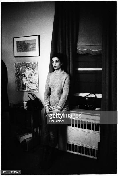 View of French artist Marisol as she stands on front of a window during a party , New York, New York, 1965.