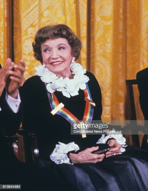 View of Frenchborn American actress Claudette Colbert during a ceremony for 1989 Kennedy Center Honorees in the White House's East Room Washington DC...