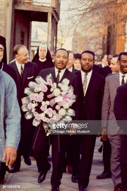 View of from center Dr Martin Luther King Jr Reverend Ralph Abernathy and Reverend Fred Shuttlesworth as they lead Reverend James Reeb's funeral...