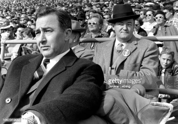 View of from fore American politicians US Representative Eugene McCarthy and US Senator Hubert Humphrey as they sit among spectators at an...
