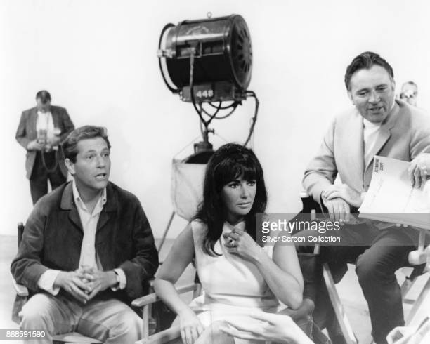 View of from left actors George Segal Elizabeth Taylor and Richard Burton as they discuss the script for the film 'Who's Afraid of Virginia Woolf'...