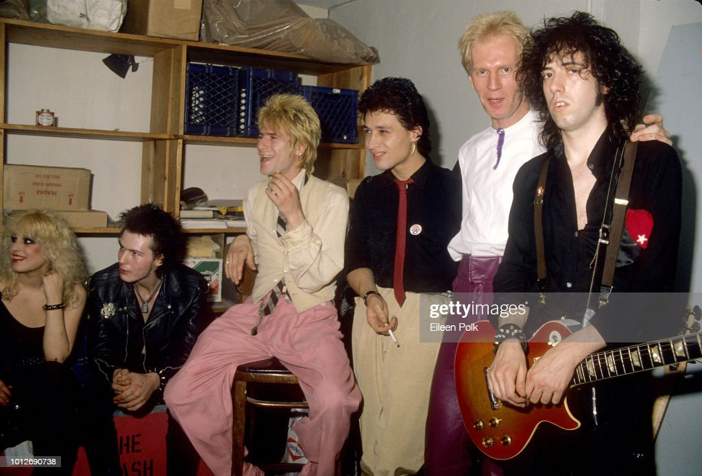 View of, from left, Amercan Nancy Spungen (1958 - 1978), musician Sid Vicious (born John Ritchie, 1957 - 1979), of the group Sex Pistols, musicians Jerry Nolan, Steve Dior, and Arthur Kane (1949 - 2004), all from the Idols, and musician Mick Jones, of the Clash, as they pose backstage at CBGBs nightclub, New York, New York, September 1978.