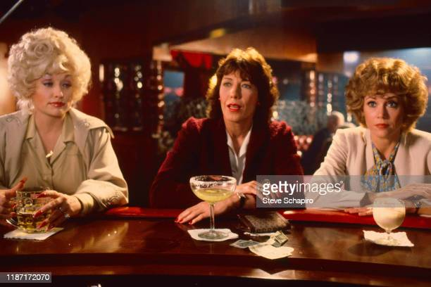 View of, from left, American actors Dolly Parton , Lily Tomlin , and Jane Fonda in a scene from the film '9 to 5' , California, 1979.