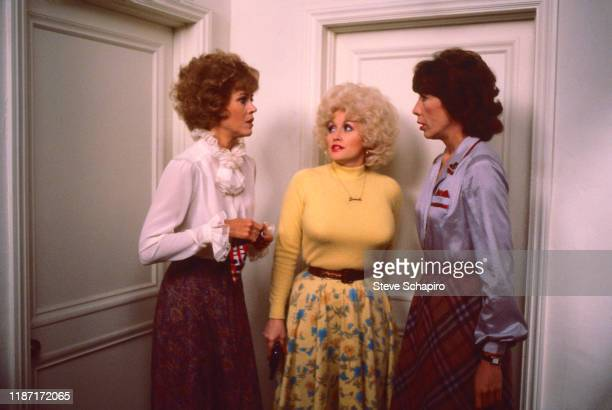 View of, from left, American actors Jane Fonda , Dolly Parton , and Lily Tomlin in a scene from the film '9 to 5' , California, 1979.