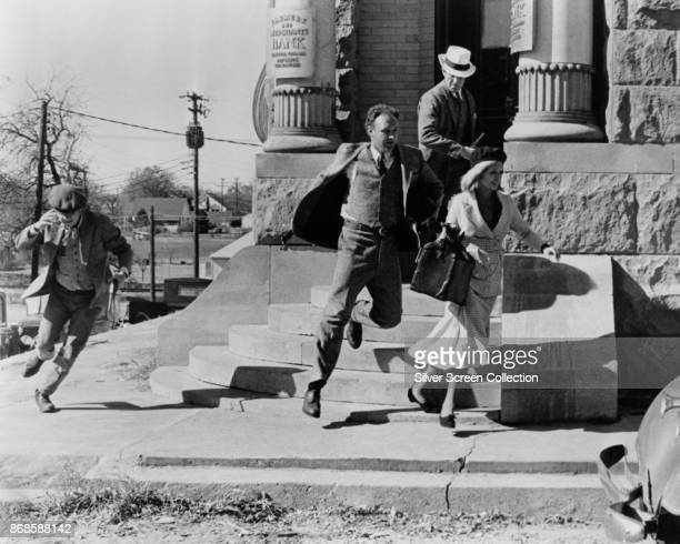 View of from left American actors Michael J Pollard Gene Hackman Warren Beatty and Faye Dunaway in a scene from 'Bonnie and Clyde' Pilot Point Texas...