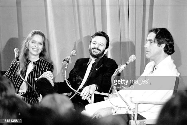 View of, from left, American actress Barbara Bach, British musician Ringo Starr, and comedian Robert Klein, during the recording of an episode of the...