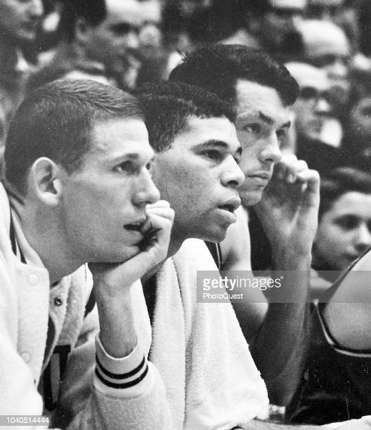 View of from left American basketball players Jeff Mullins Willie Jones and Bill Bradley as they sit on the sidelines during the elimination...