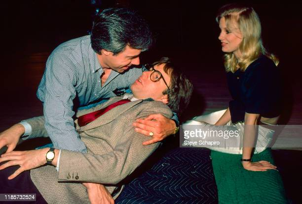 View of from left American film director Peter Bogdanovich actor John Ritter and Canadian actress Dorothy Stratten on the set of their film 'They All...
