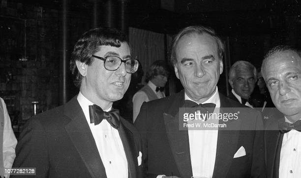 View of from left American journalist Edward Kosner Australianborn American media executive Rupert Murdoch and attorney Roy Cohn as they attend...