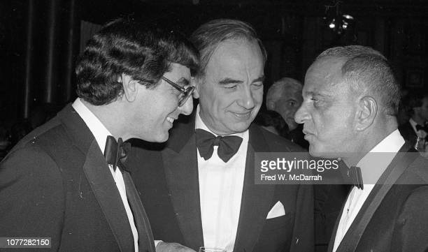View of from left American journalist Edward Kosner Australianborn American media executive Rupert Murdoch and attorney Roy Cohn as they talk...