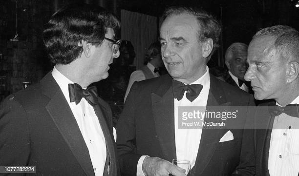 View of, from left, American journalist Edward Kosner, Australian-born American media executive Rupert Murdoch, and attorney Roy Cohn as they talk...