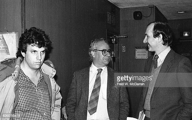 View of from left American journalists Joe Conason Jack Newfield and Wayne Barrett as they stand in a hallway at an unspecified political event New...