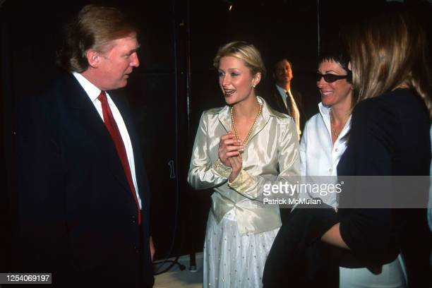 View of from left American real estate developer Donald Trump model and heiress Paris Hilton and British socialite Ghislaine Maxwell as they talk...