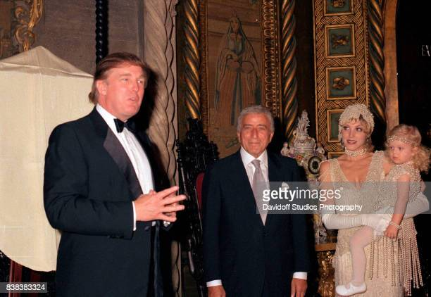View of, from left, American real estate developer Donald Trump, musician Tony Bennett, actress Marla Maples, and her daughter, Tiffany Trump, during...