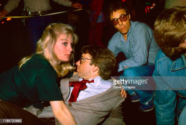 View of from left Canadian actress Dorothy Stratten American actor John Ritter and film director Peter Bogdanovich on the set of their film 'They All...