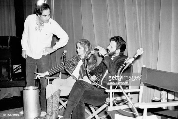 View of, from left, comedian Robert Klein, American actress Barbara Bach, and British musician Ringo Starr during a pause in the recording of the...