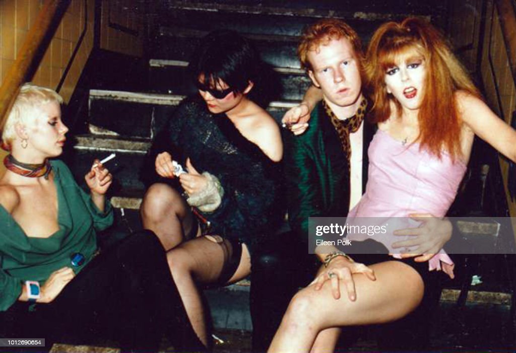 View of, from left, Debbie 'Revenge' Wheeler, band manager and photographer Anya Phillips (1955 - 1981), and musicians Cheetah Chrome, of the Dead Boys, and Gyda Gash as they sit on a staircase at an unidentified nightclub, New York, New York, 1978.