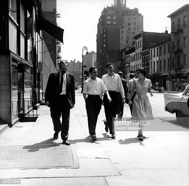 View of from left Ed Fancher Dan Wolf and Jerry and Louise Tallmer of the Village Voice as they walk along Greenwich Avenue New York New York August...
