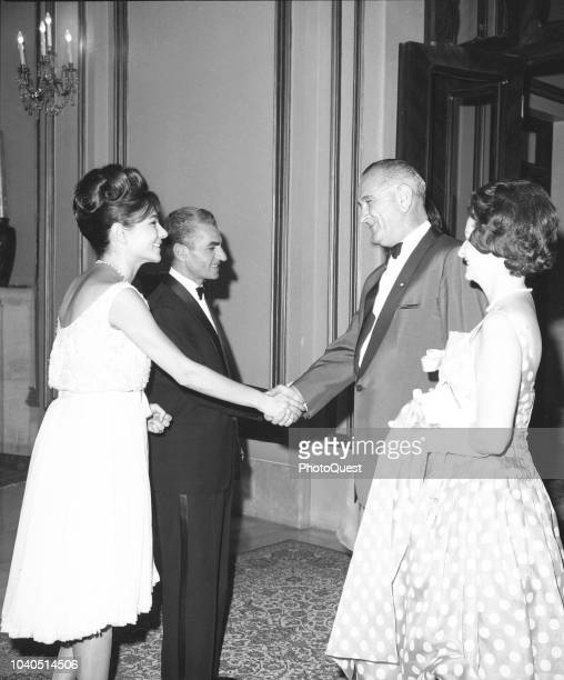 View of from left Empress consort of Iran Farah Pahlavi and Shah of Iran Mohammad Reza Pahlavi greet US Vice President Lyndon B Johnson and First...
