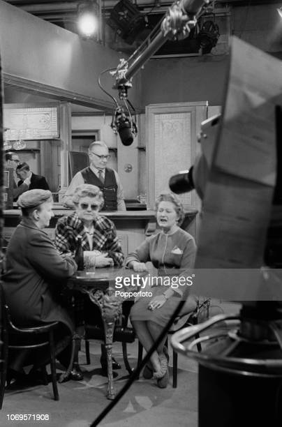 View of from left English actresses Margot Bryant as Minnie Caldwell and Violet Carson as Ena Sharples pictured together with another actress during...