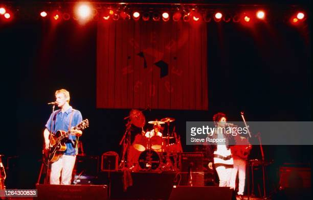 View of, from left, English musician Paul Weller, Steve White, Dee C Lee, all of the group the Style Council, Red Wedge Tour, Hammersmith Odeon,...