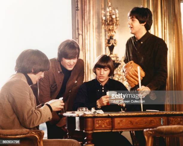 View of from left English musicians George Harrison John Lennon Ringo Starr and Paul McCartney all of the group the Beatles as they appear in a scene...