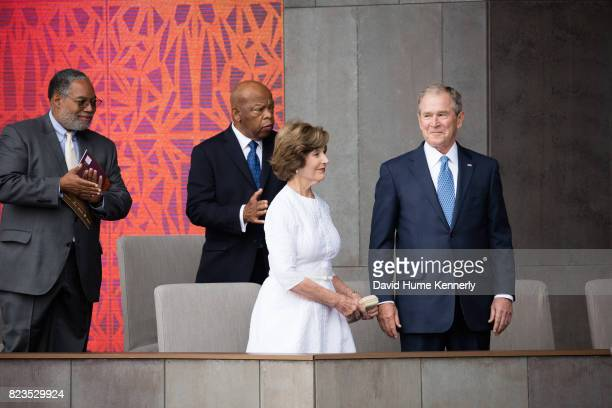 View of from left founding director Lonnie Bunch Congressman John Lewis former First Lady Laura Bush and former President George W Bush as they...