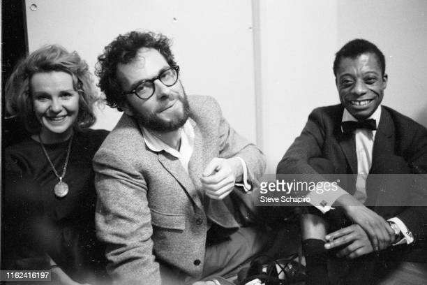 View of from left married American actors Geraldine Page and Rip Torn and author activist James Baldwin as they sit together on the floor during an...