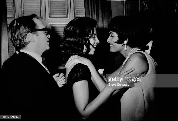 View of, from left, married American couple, film director Sidney Lumet and author Gail Jones Lumet , the latter of whom shares a smile with and...