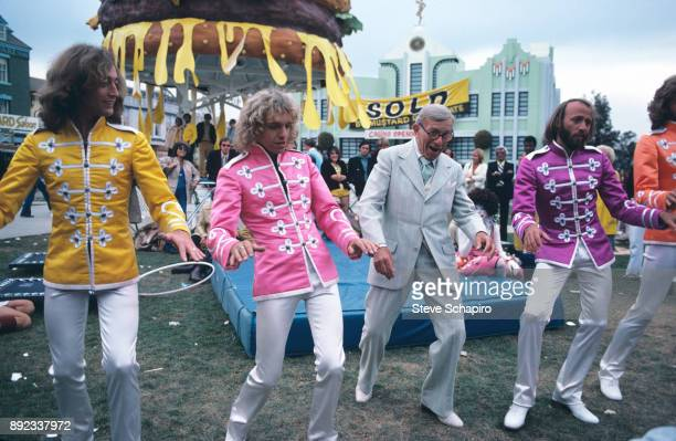 View of from left musicians Robin Gibb and Peter Frampton comedian George Burns and musicians Maurice and Barry Gibb in the film 'Sgt Pepper's Lonely...