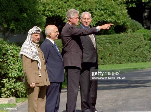 View of, from left, Palestinian Authority Chairman Yassir Arafat , King Hussein of Jordan , US President Bill Clinton, and Israeli Prime Minister...