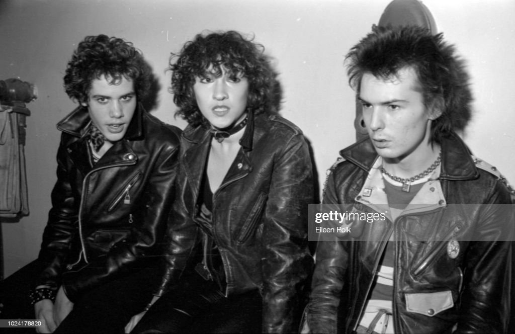 View of, from left, Rick Static, Michele Robison, and British musician Sid Vicious (born John Simon Ritchie, aka John Beverly, 1957 - 1979) as they sit backstage at the Palladium, New York, New York, November 12, 1978)(. They were there to attend a concert by Blondie and the Heartbreakers.