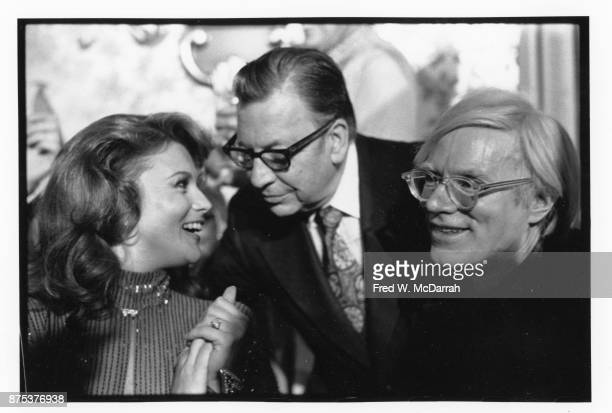 View of from left Swedishborn American actress AnnMargret journalist magazine editor Bob Colacello and Pop artist Andy Warhol as they attend an...