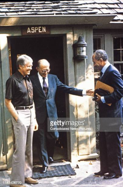 View of from left US President Jimmy Carter Israeli Prime Minister Menachem Begin and Egyptian President Anwar Al Sadat as they greet one another...
