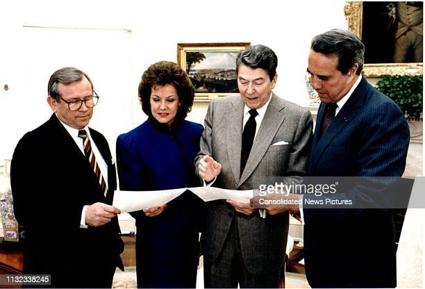 View of, from left, White House Chief of Staff Howard Baker , US Secretary of Transportation Elizabeth Dole, US President Ronald Reagan , and US...