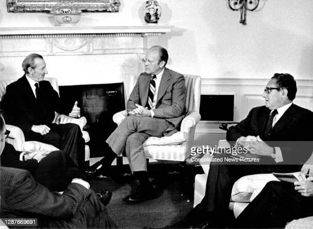View of, from rear left, Secretary-General of the United Nations Kurt Waldheim , US President Gerald Ford and Secretary of State Henry Kissinger in...