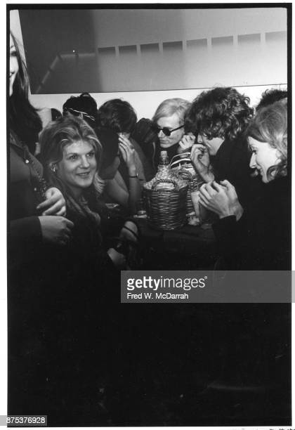 View of from second left American actress and artist Brigid Berlin Pop artist Andy Warhol film director Paul Morrissey and American actress Viva as...