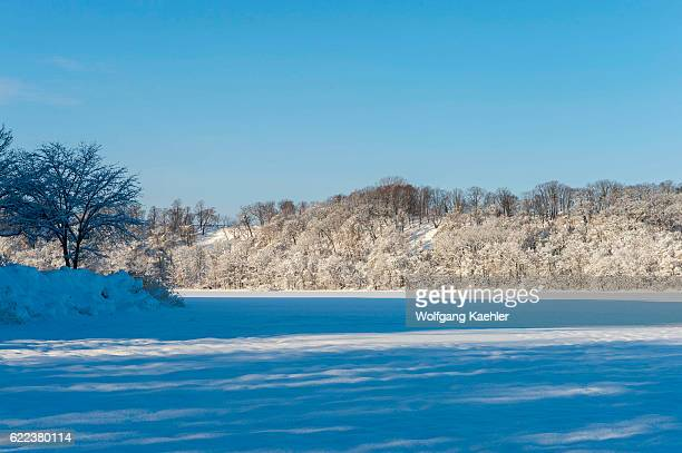 View of frozen Lake Abashiriko and forest covered with snow near Abashiri a city on Hokkaido Island Japan