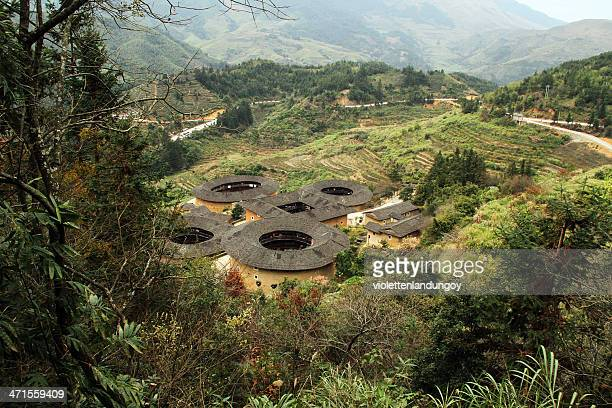 view of fujian earthen structures, china - fujian tulou stock pictures, royalty-free photos & images