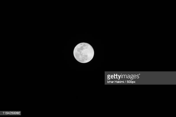 view of full moon on sky - hakimi stock photos and pictures