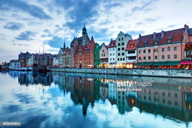 view of gdansk old town and motlawa river, poland at sunset - motlawa river stock pictures, royalty-free photos & images