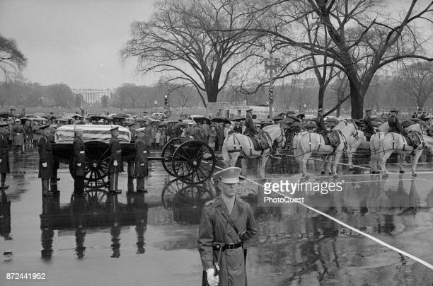 View of General Douglas MacArthur's funeral procession with a flagdraped casket on a horsedrawn caisson on the way to the Capitol where the coffin...