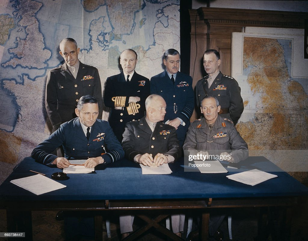View of General Dwight D Eisenhower (1890-1969) pictured with senior members of Allied Supreme Command Allied Expeditionary Force (SHAEF) sitting and standing behind a table in conference at their headquarters in London on 1st February 1944. The group are, back row from left to right: General Omar Bradley (1893-1981), Admiral Bertram Ramsey (1883-1945), Air Chief Marshal Trafford Leigh-Mallory (1892-1944) and General Walter Bedell Smith (1895-1961). Front row from left to right, Air Chief Marshal Arthur Tedder (1890-1967), Dwight D. Eisenhower and General Bernard Montgomery (1887-1976).