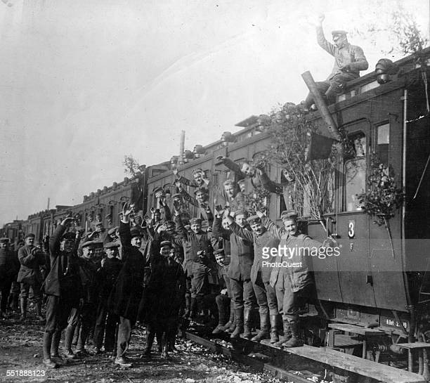 View of German troops as they wave from a train headed home after the signing of the Armistice which ended World War I 1918