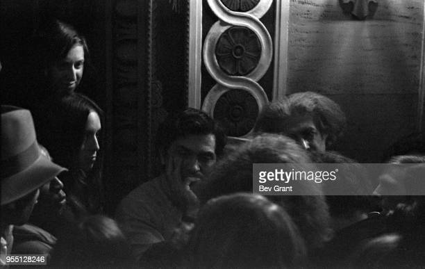 View of Germanborn American concert promotor Bill Graham surrounded by unidentified others in the lobby of the Filmore East during the venue's...