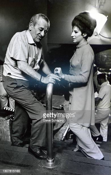 View of German-born American film director William Wyler and American actress and singer Barbra Streisand on the set of their film 'Funny Girl,' Los...