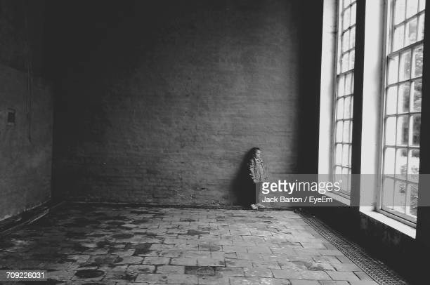view of girl in empty room - sadgirl stock pictures, royalty-free photos & images
