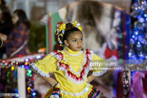 view of girl in traditional clothing - steven cottingham stock-fotos und bilder
